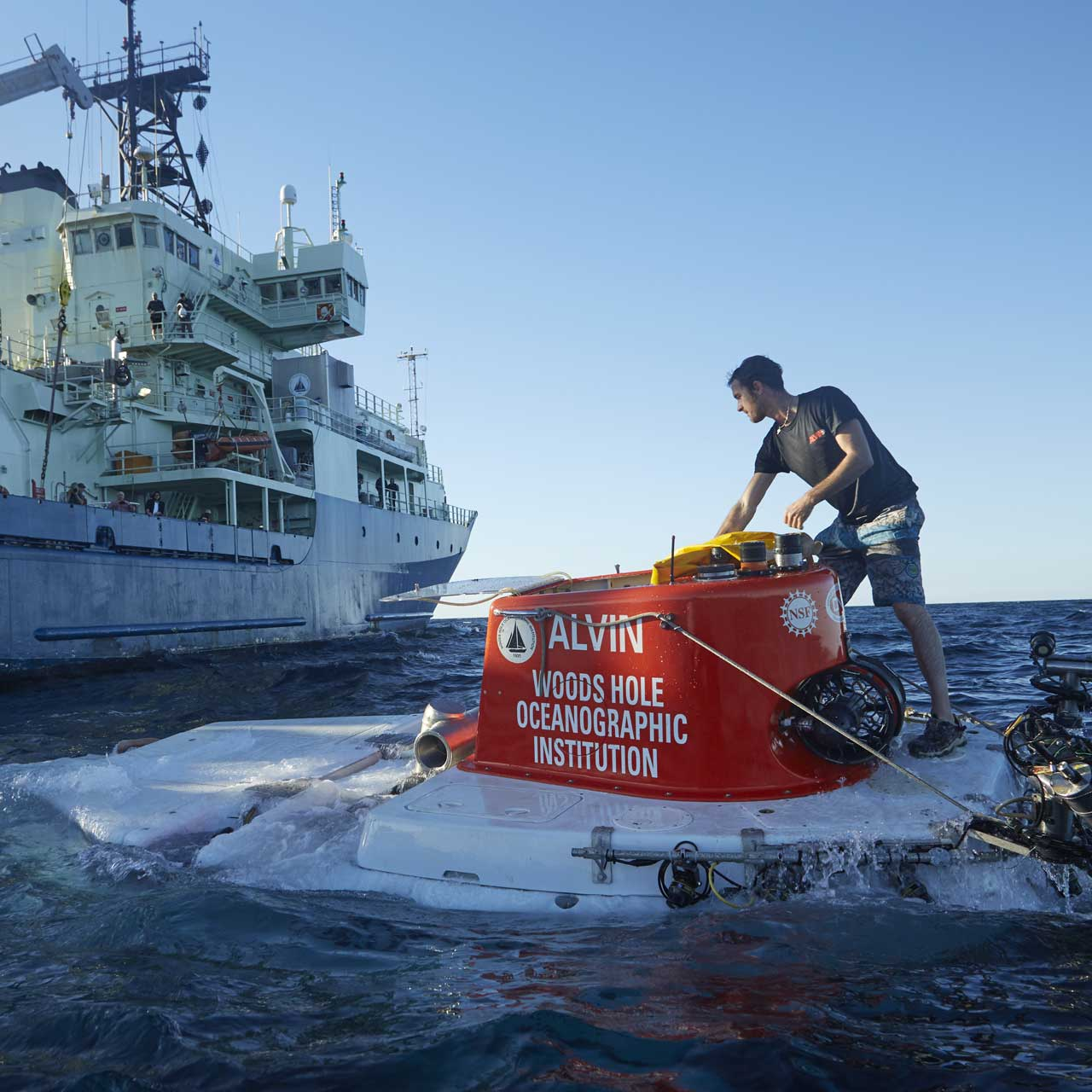 An Alvin team member prepares the sub for recovery after its 5000th dive in November 2018. (Photo by Drew Beweley, ©Woods Hole Oceanographic Institution)